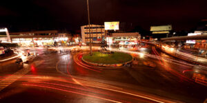 hubli dharwad chennama circle traffic island hubli evening photo with traffic lights trailing slow exposure photograph